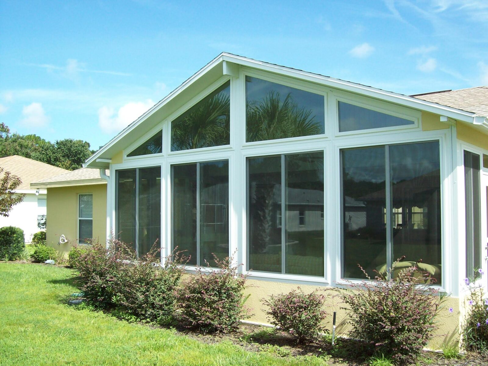 The Villages sunroom window wall with tall windows