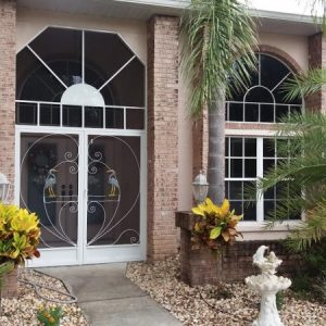 Front-entry decorative screen doors with custom painted cranes