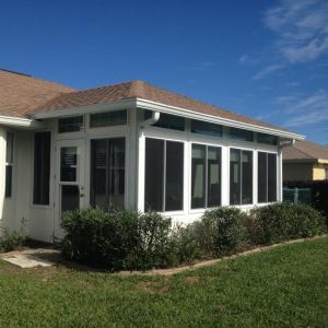 Overview of the finished product from the backyard - Sunroom with tall, white windows