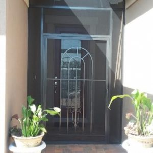 Closeup - Front-entry screened enclosure with bronze frame and decorative door