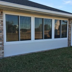 Three replacement windows front of house