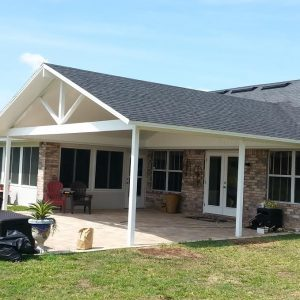 Overview of the roof and matching shingles and overview of patio cover - Patio cover with shingles to match the home