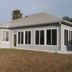 Outside corner overview - Sunroom with tall, white windows and backdoor