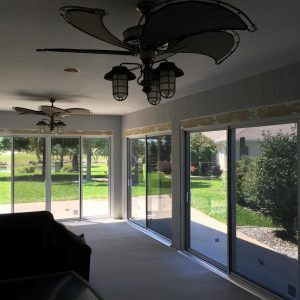 Sliding glass door sunroom / glass room with two fans